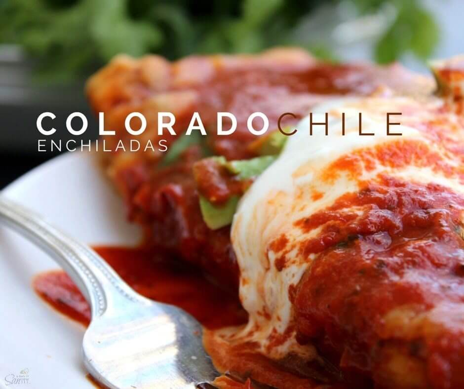 Colorado Chile Enchiladas close up on a plate with a fork.