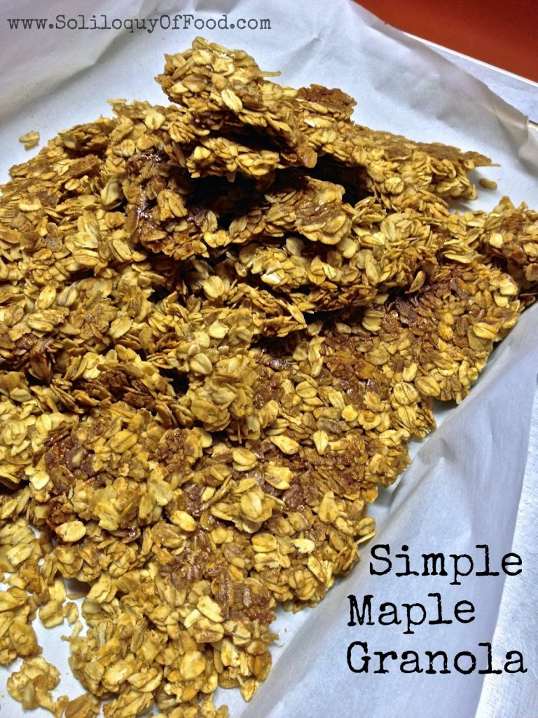 Simple Maple Granola on parchment paper.