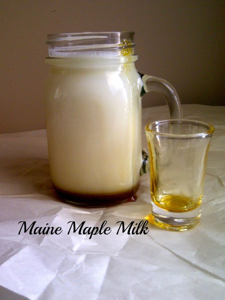 Maine Maple Milk in a glass jar with a shot glass.