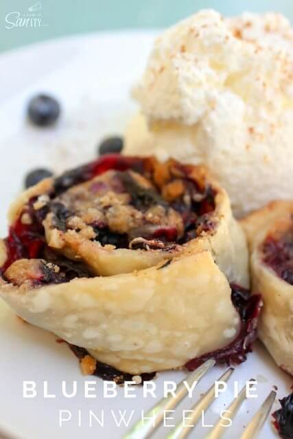 Blueberry Pie Pinwheels on a plate with ice cream.