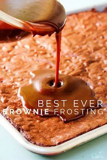 Best Ever Brownie Frosting being poured over brownies in the pan.