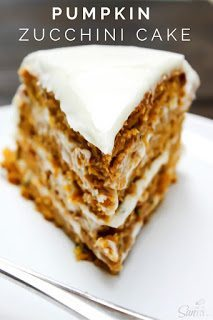 Pumpkin Zucchini Cake on a white plate with a fork.