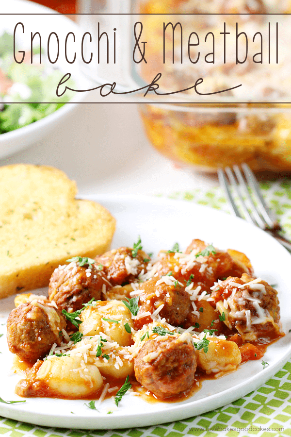 Gnocchi and Meatball Bake on a plate with garlic bread and a fork.