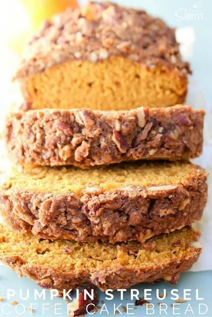 Pumpkin Streusel Coffee Cake Bread sliced on a cutting board close up.