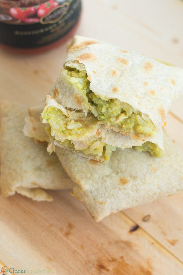 Baked Chicken & Avocado Chimichangas on a cutting board.