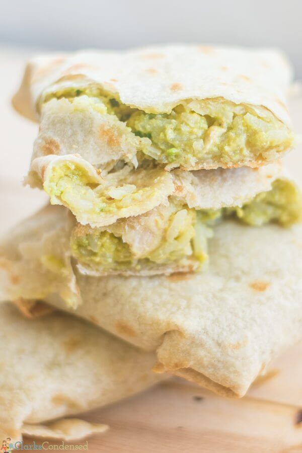 Baked Chicken & Avocado Chimichangas close up with the inside ingredients showing.