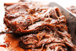 Easy Barbecue Beef Brisket on a cutting board.