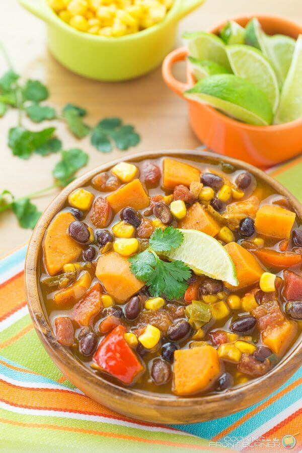 Sweet Potato and Black Bean Soup in a brown bowl with lime and corn.