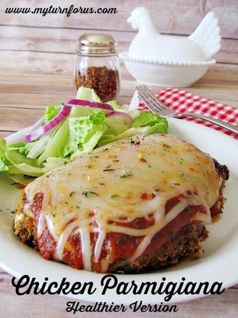Healthier Version Chicken Parmigiana on a white plate close up.