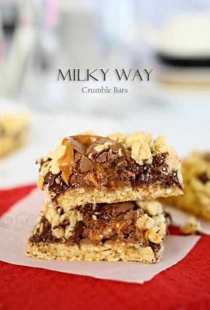 Milky Way Crumble Bars stacked up on a plate.
