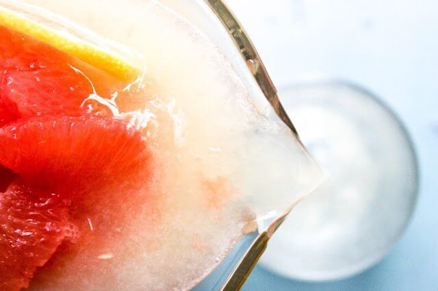 Pink Grapefruit Spritzer being poured into a glass.