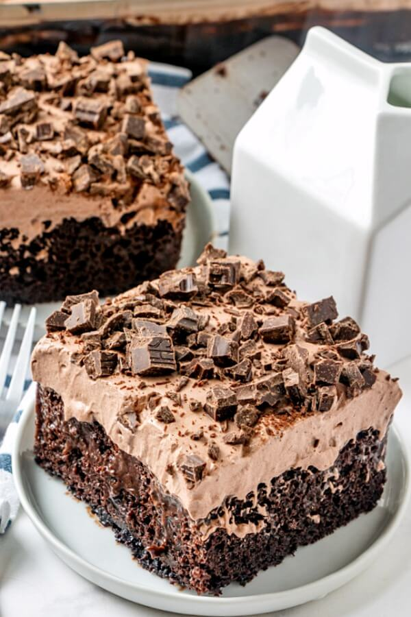 death by chocolate poke cake slice on plate