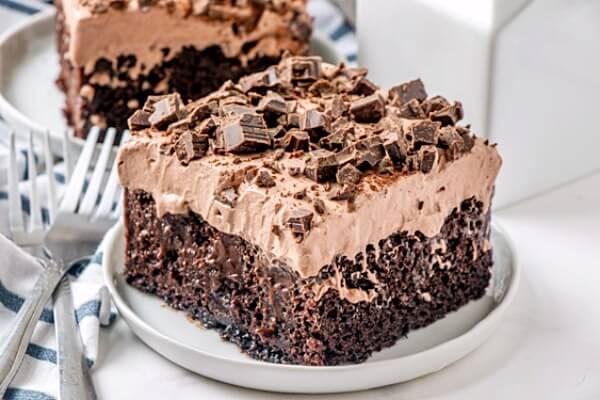 chocolate poke cake slice on plate