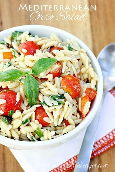 Mediterranean Orzo Salad in a bowl with a spoon.