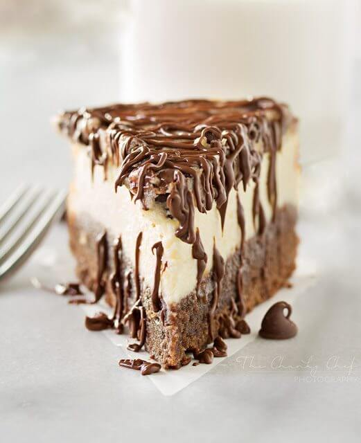 Brownie Bottom Cookie Dough Cheesecake with a fork.