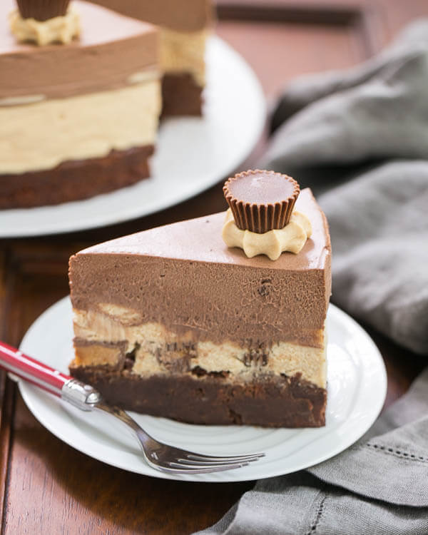 Peanut Butter Chocolate Mousse Cake on a white plate with a fork.