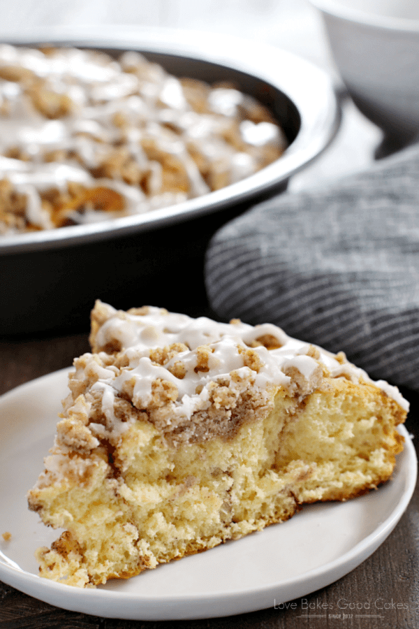 Cinnamon Roll Crumb Cake on a white plate close up.