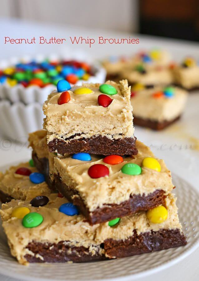 Peanut Butter Whip Brownies stacked on a plate.