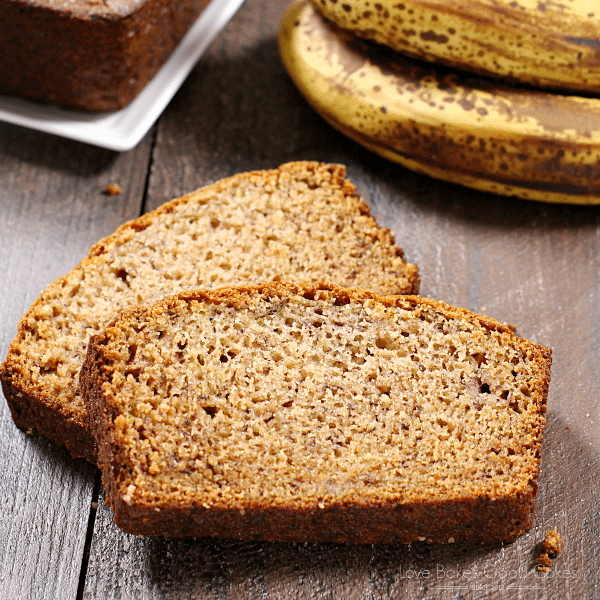 Banana Bread slices with bananas close up.