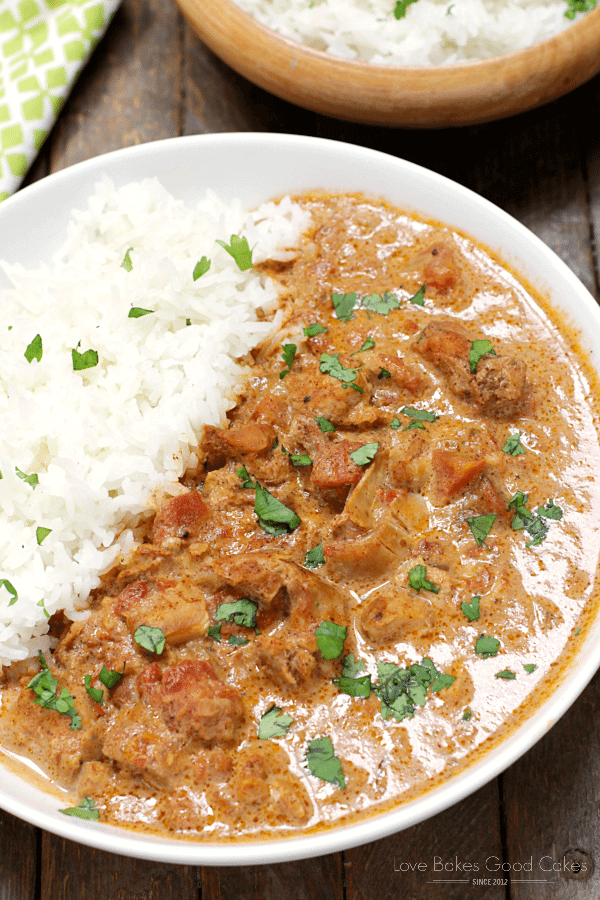 Slow Cooker Chicken Tikka Masala on a white plate with rice close up.