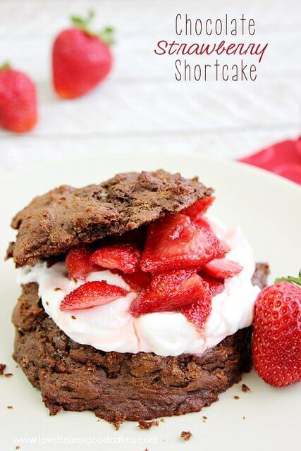 Chocolate Strawberry Shortcake on a white plate with fresh strawberries.