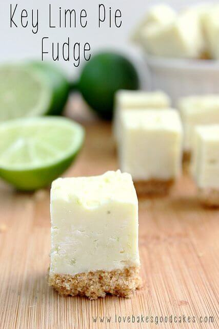 Key Lime Pie Fudge squares on a cutting board with fresh limes.