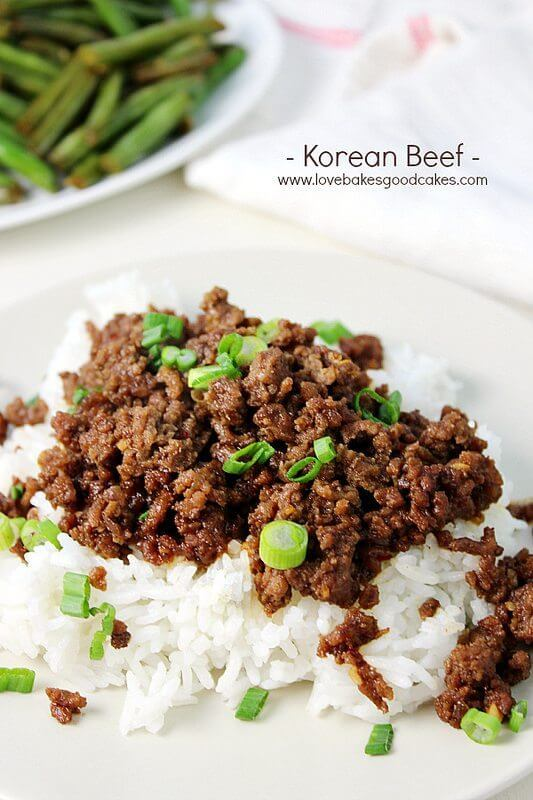 Korean Beef on a white plate with green beans.