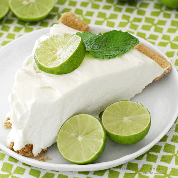 No-Bake Key Lime Pie on a white plate with limes close up.