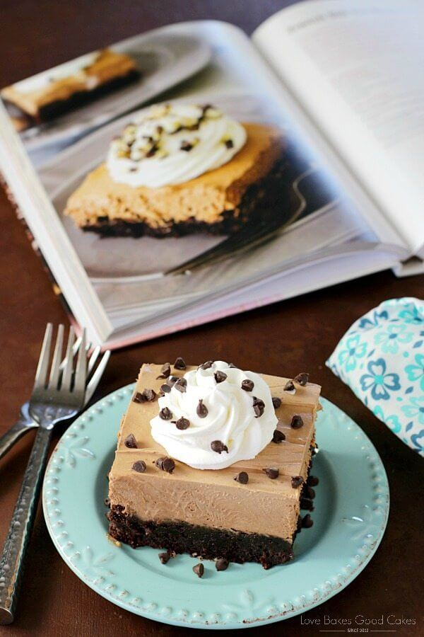 French Silk Pie Brownies on a blue plate with chocolate chips and a fork.