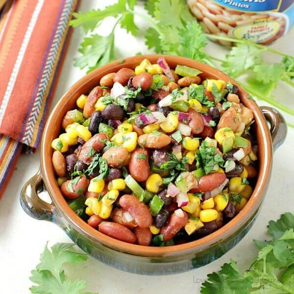 Mexican Bean Salad in a brown bowl close up.