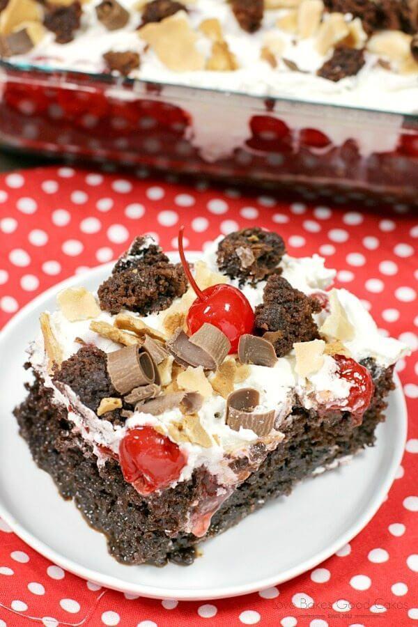 Waffle Cherry Brownie Poke Cake on a white plate close up.