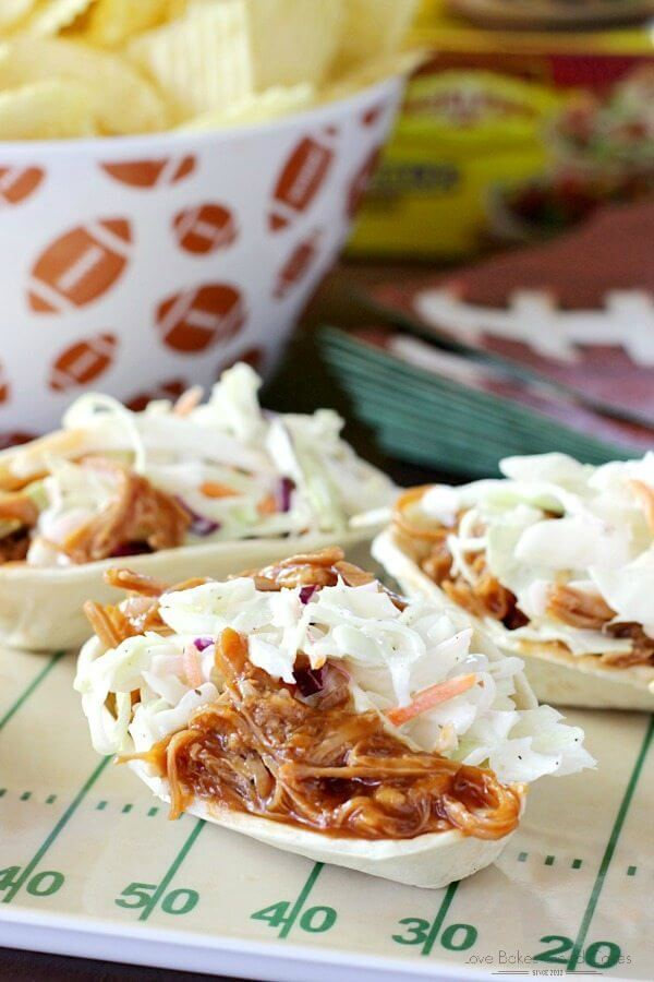 Southern-Style BBQ Pork and Coleslaw Mini Taco Boats with a bowl of potato chips.
