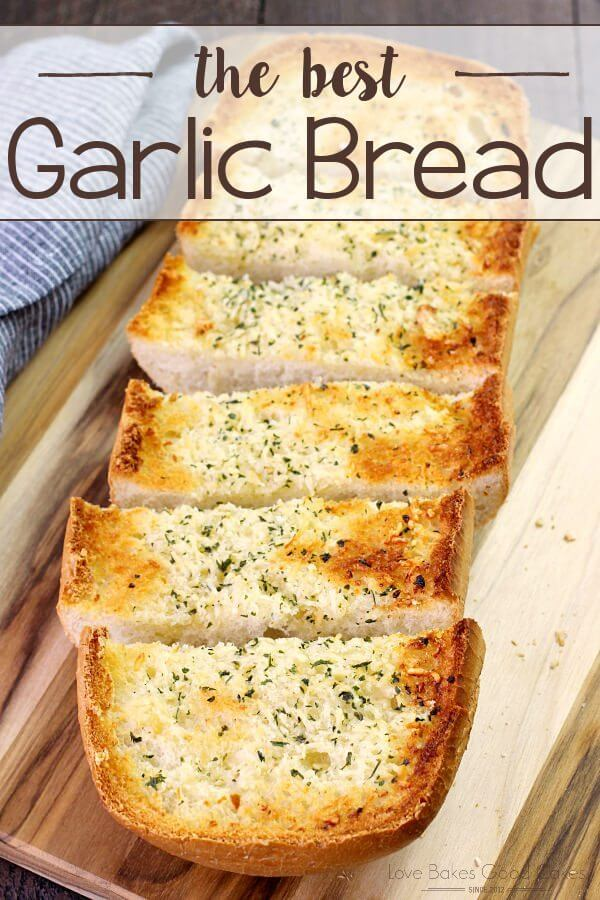 BEST Garlic Bread sliced on a cutting board