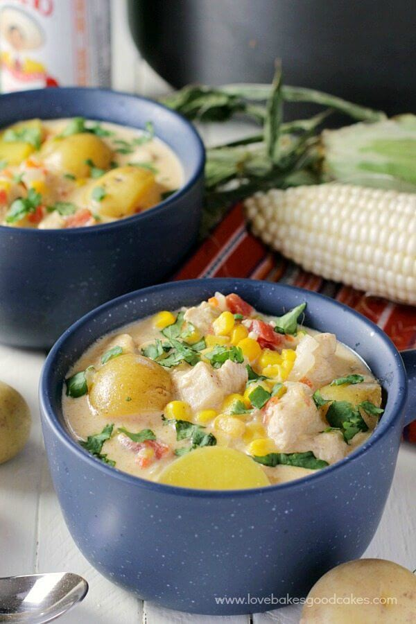 Mexican Chicken & Corn Chowder in two bowls with a spoon.