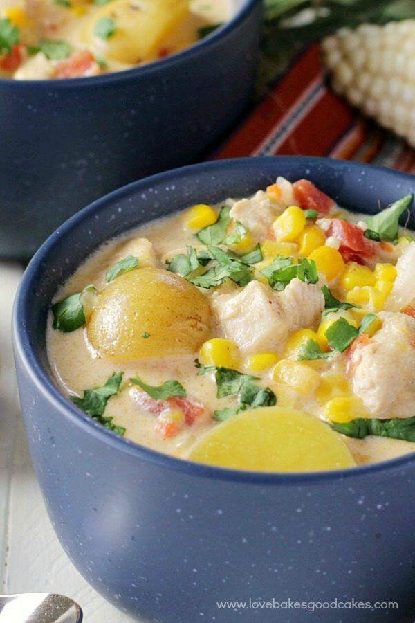 Mexican Chicken & Corn Chowder in two blue bowls.