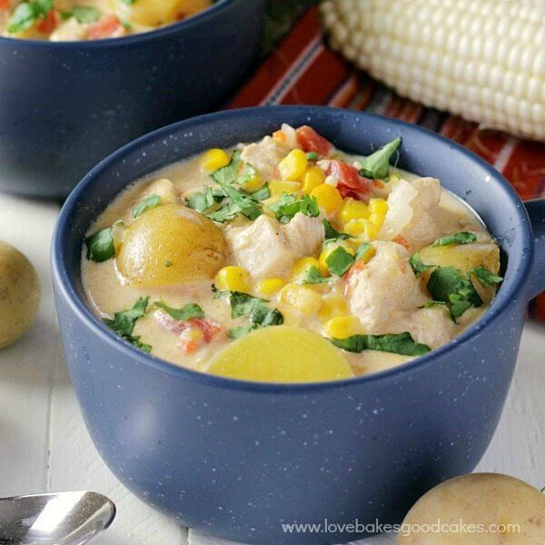 Mexican Chicken & Corn Chowder in a blue bowl with a spoon.