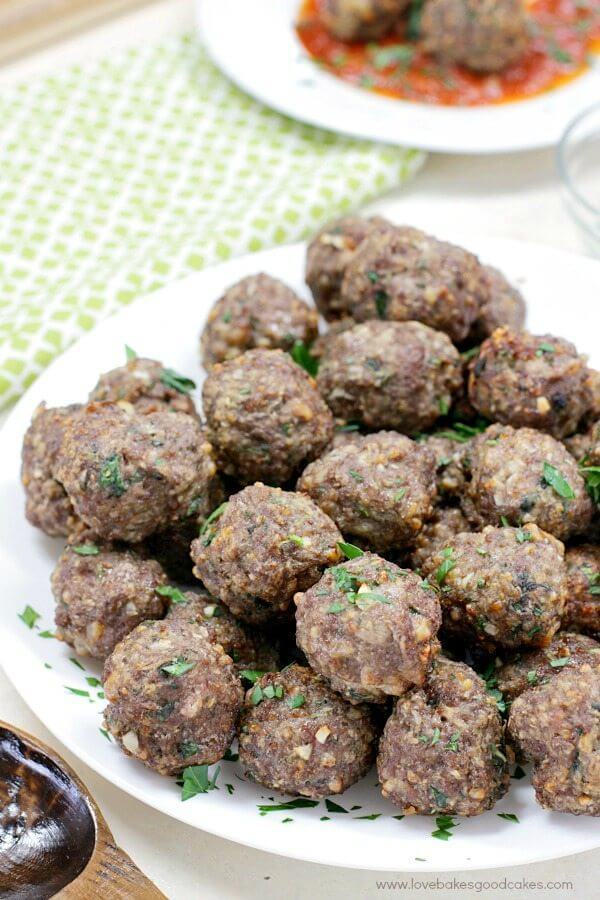 Italian Herb Baked Meatballs piled up on a plate.