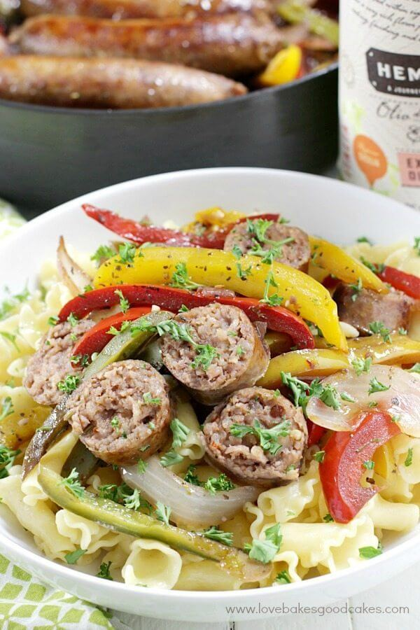 Rustic Italian Sausage with Peppers and Onions in a white bowl.