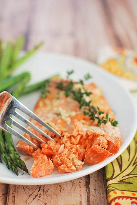 Easy Honey Salmon with Asparagus on a plate with a fork.