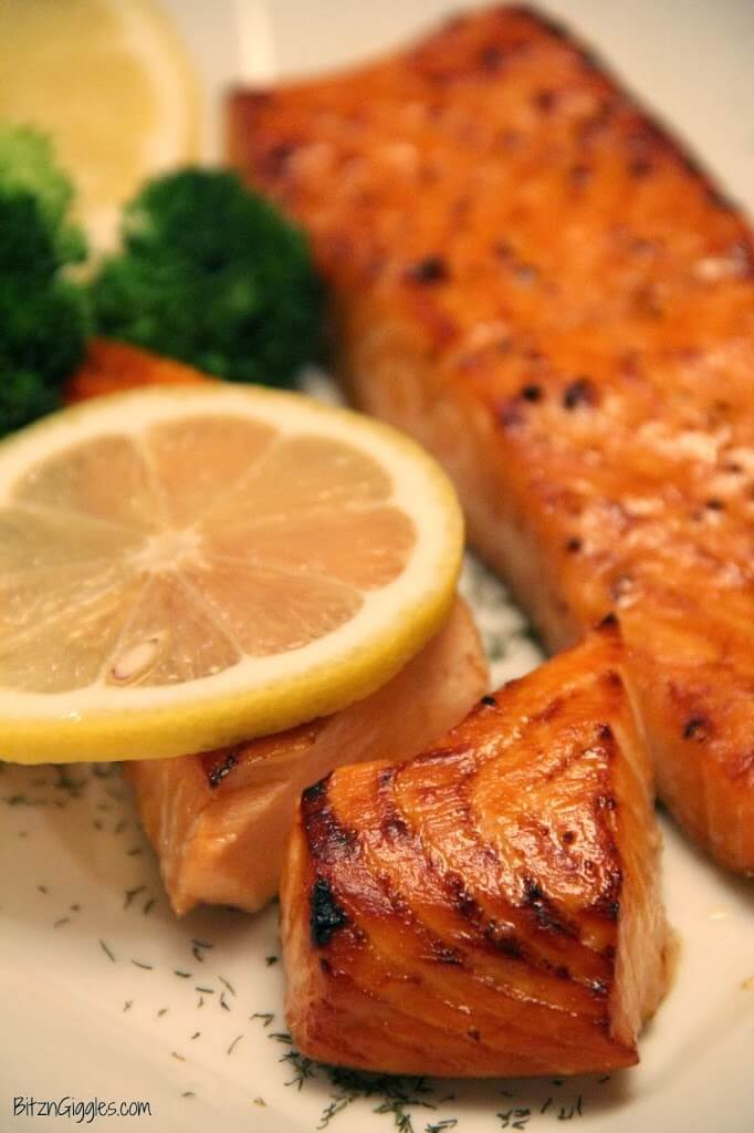 Brown Sugar Salmon on a plate with a lemon slice.