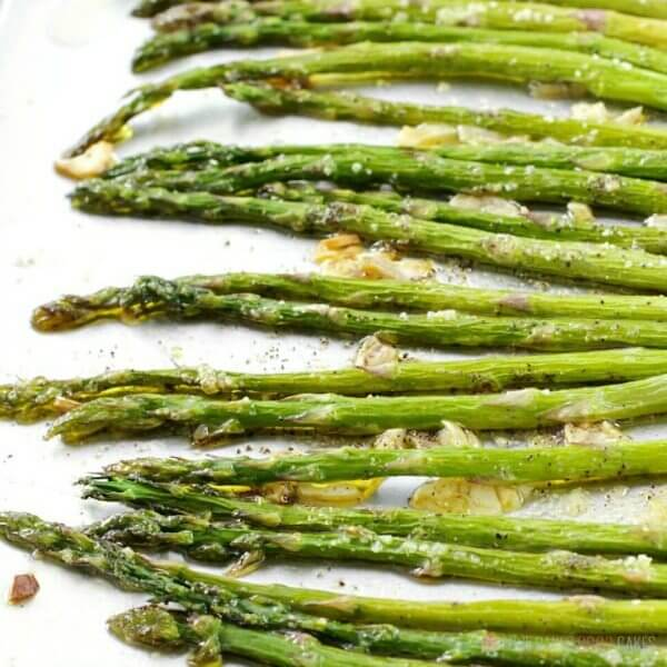 Oven-Roasted Asparagus on a plate close up.
