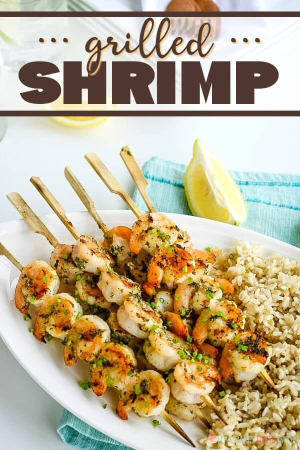 Grilled Shrimp Kabobs served with brown rice and lemon wedges.