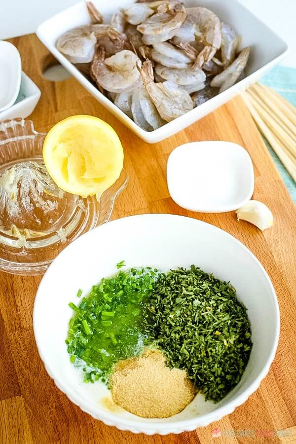 Ingredients added to a bowl for a marinade for shrimp.