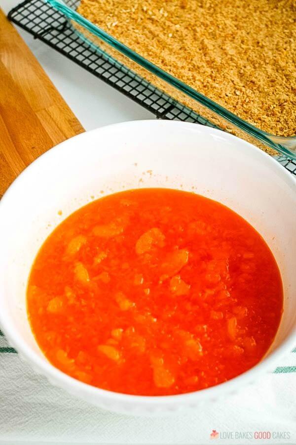 orange jello with Mandarin oranges in bowl