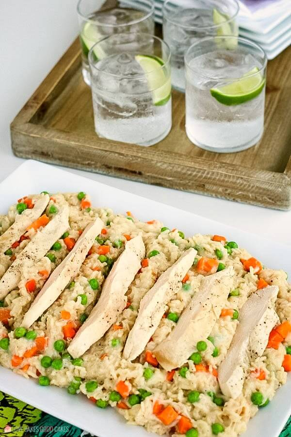 A chicken and rice recipe served for dinner with drinks.