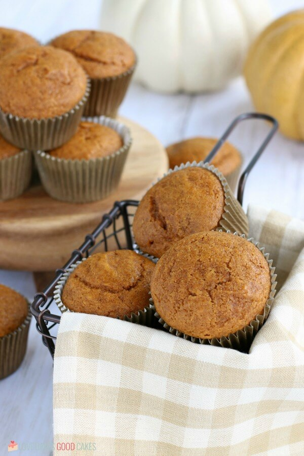 Pumpkin muffins in a cloth lined wired basket.