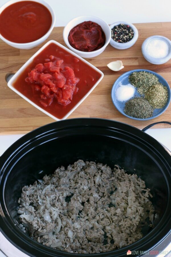 Browned pork sausage with onions and other ingredients for a Spaghetti Sauce Recipe.