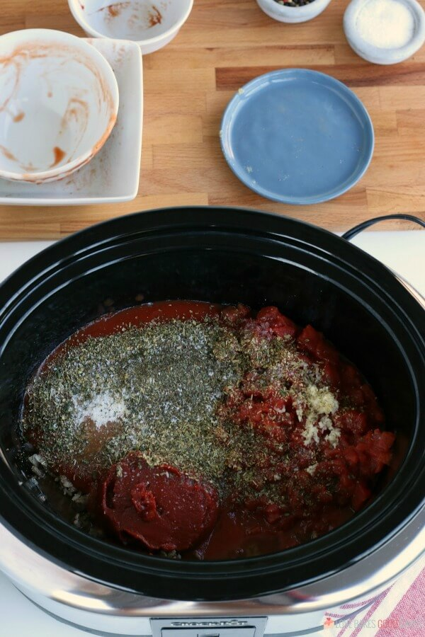 Spices and sauces added to the Crock Pot to make Spaghetti Sauce.