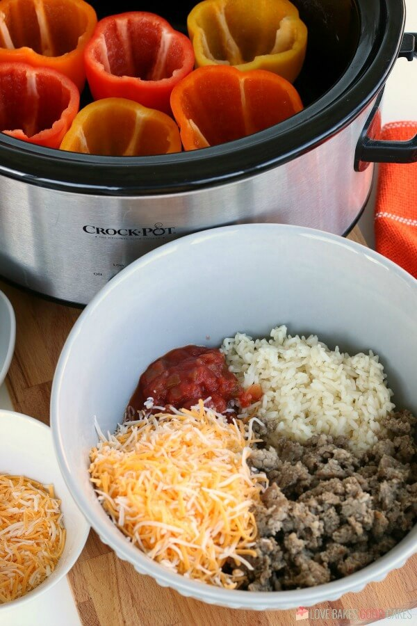 Ground beef, rice, salsa and cheese go into our stuffed peppers in the crockpot.