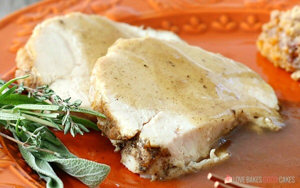 Horizontal image showing an up close view of the Instant Pot turkey breast with gravy on a plate.